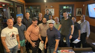 'Brock and Bros' fantasy football league pose for photo at Hooters