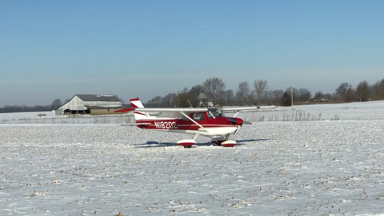 Small plane lands safely then takes off from snow-covered field in Johnson County
