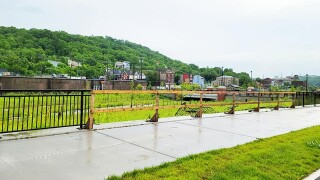Wooden planks sit where new fencing along a new park in South Fairmount was flattened due to vehicle crashes.