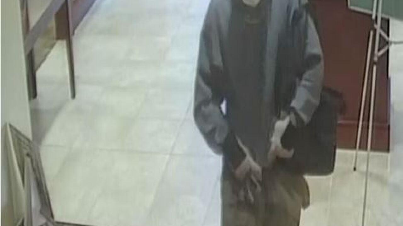 Police investigating bank robbery involving...