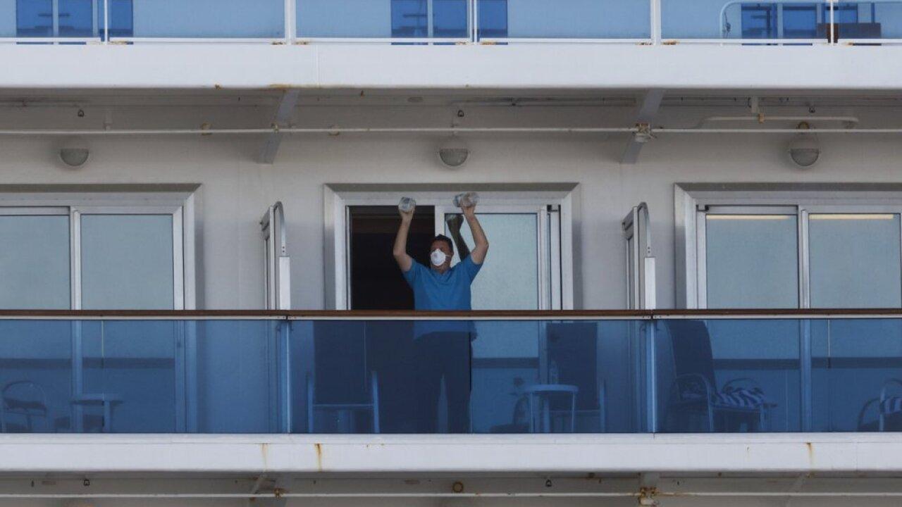 Passengers begin leaving after ship's virus quarantine ends