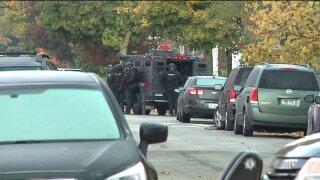 Standoff in GR with murder suspect
