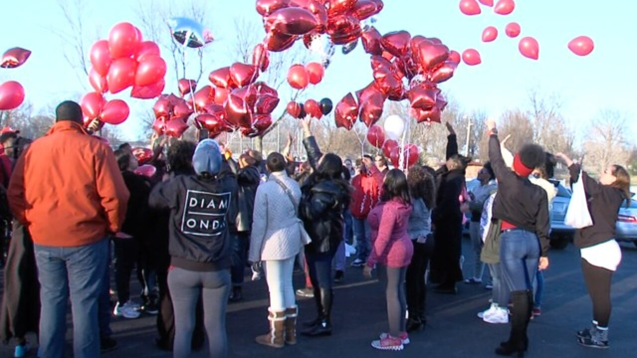 Family pleads for end to gun violence at vigil