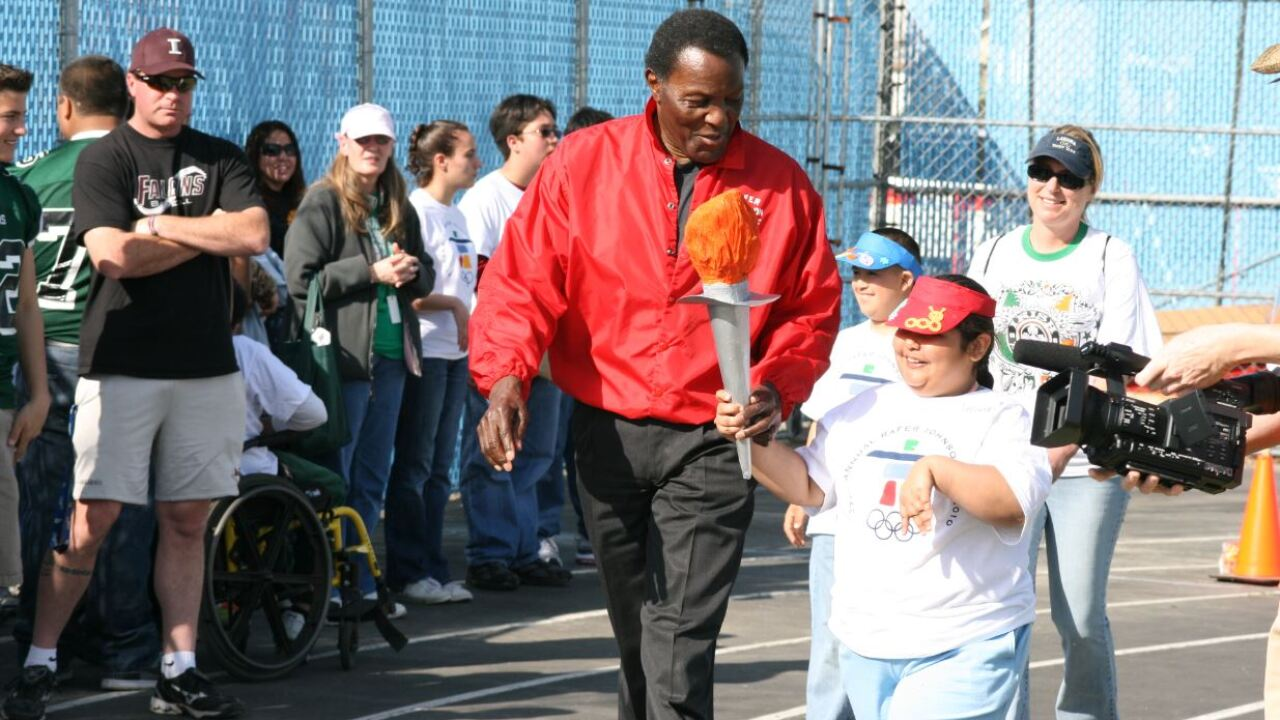 Rafer Johnson with school torch.JPG