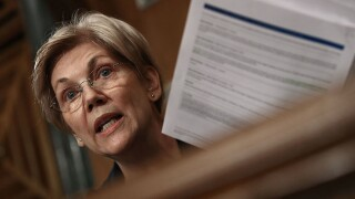 Warren knocks Obama, teases 2020 bid