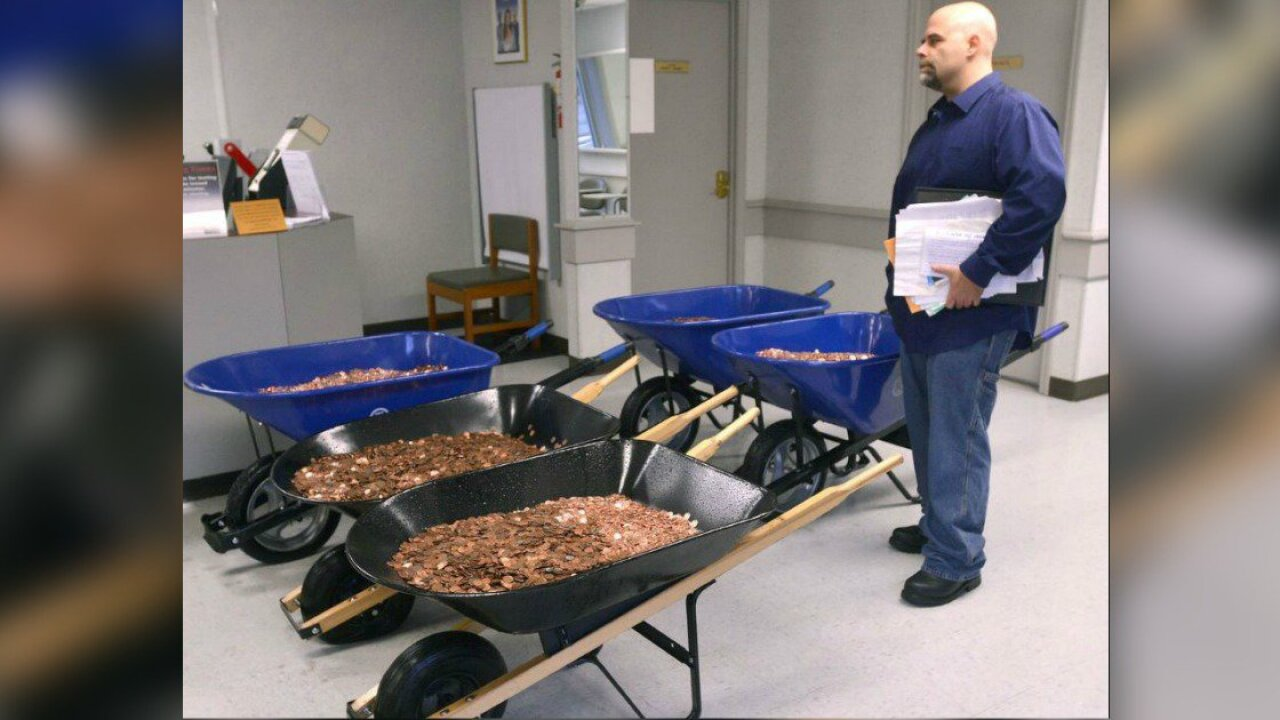 Man brings 300,000 pennies to DMV to 'inconvenience' the state