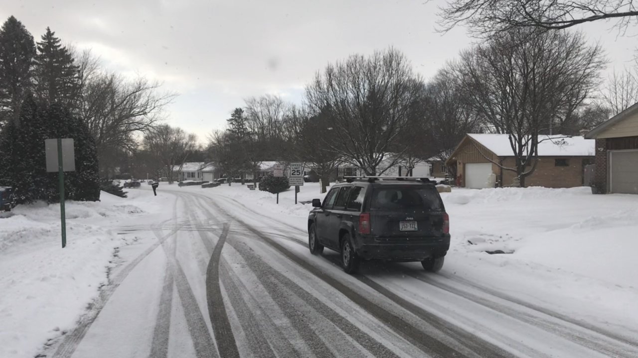 Jeep vehicle tries to navigate snow-covered road in Milwaukee area