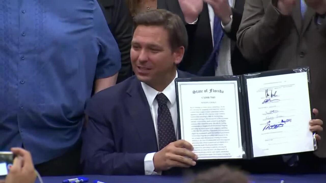 Florida Gov. Ron DeSantis signs HB 7045 at St. John the Apostle Catholic School in Hialeah on May 11, 2021.jpg