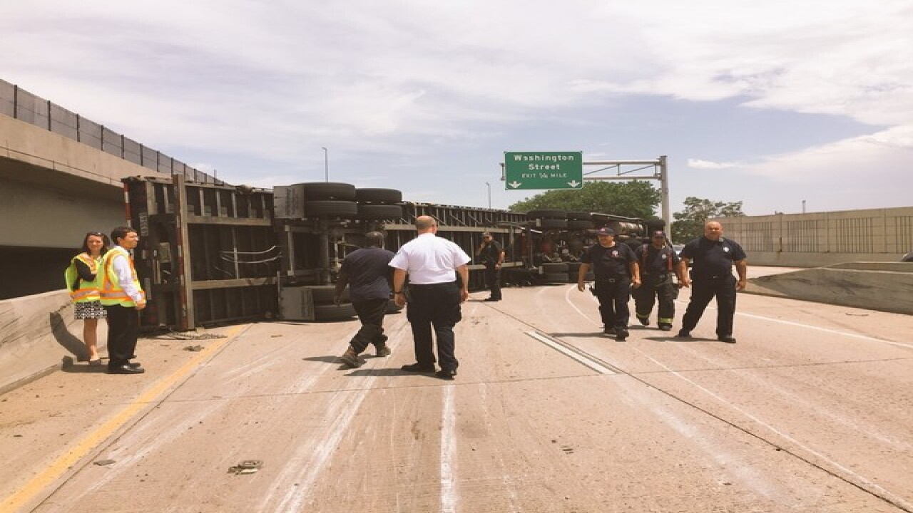 Overturned semi shuts down I-25 ramp to I-70