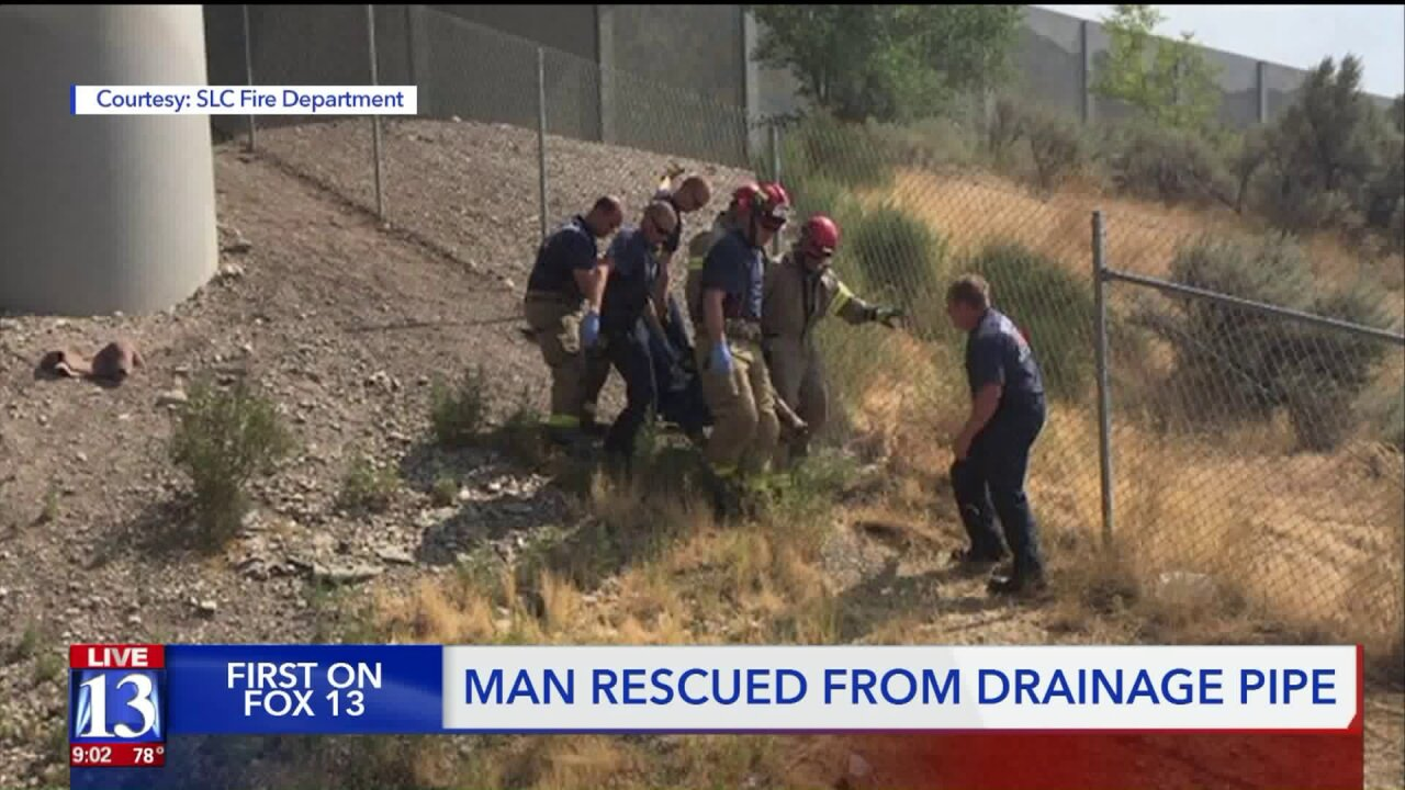 Man rescued after spending hours trapped in a SLC drainage pipe
