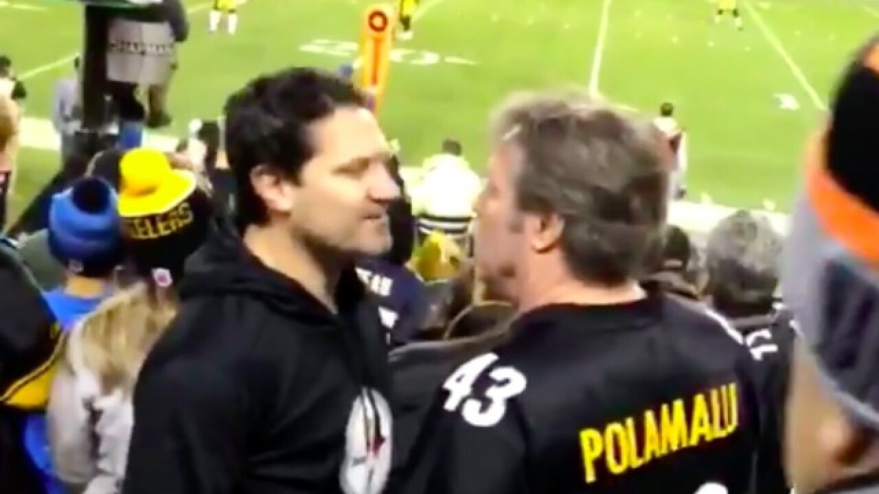 steelers fans fight each other during sunday night football game