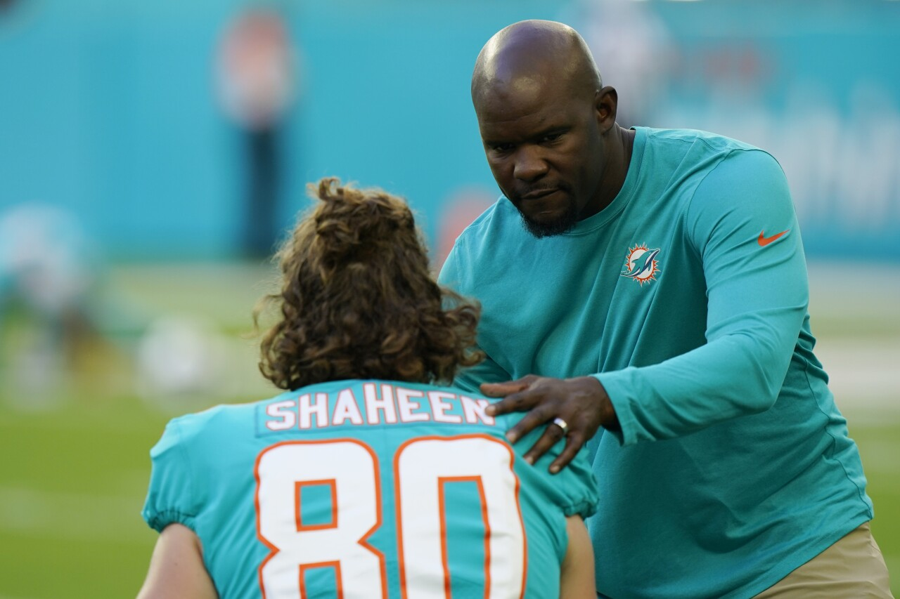 Miami Dolphins head coach Brian Flores speaks to tight end Adam Shaheen on sideline vs. Atlanta Falcons in 2021
