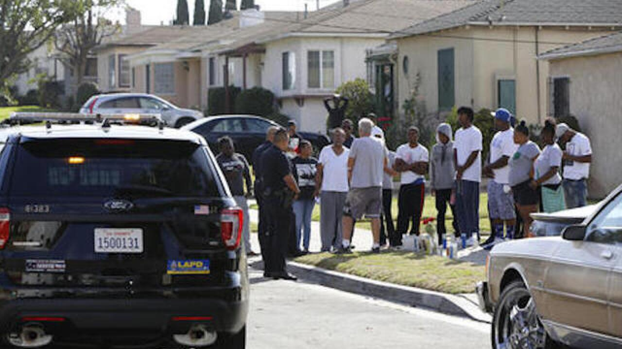 Los Angeles police say shooting victim had loaded handgun