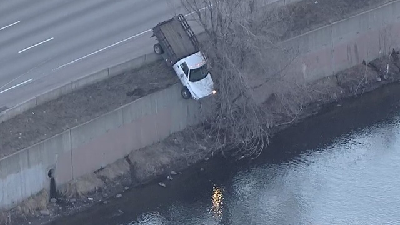 Truck hangs over edge of I-25 above Platte River