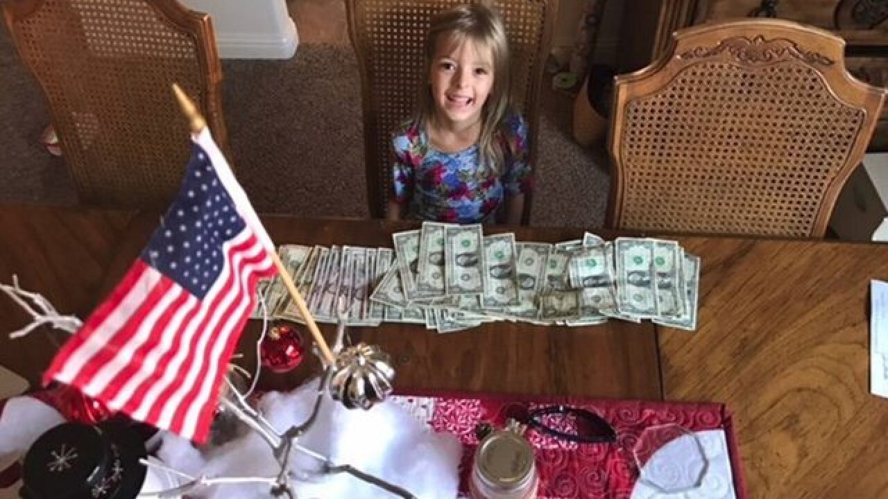 Girl gives savings for fallen firefighters