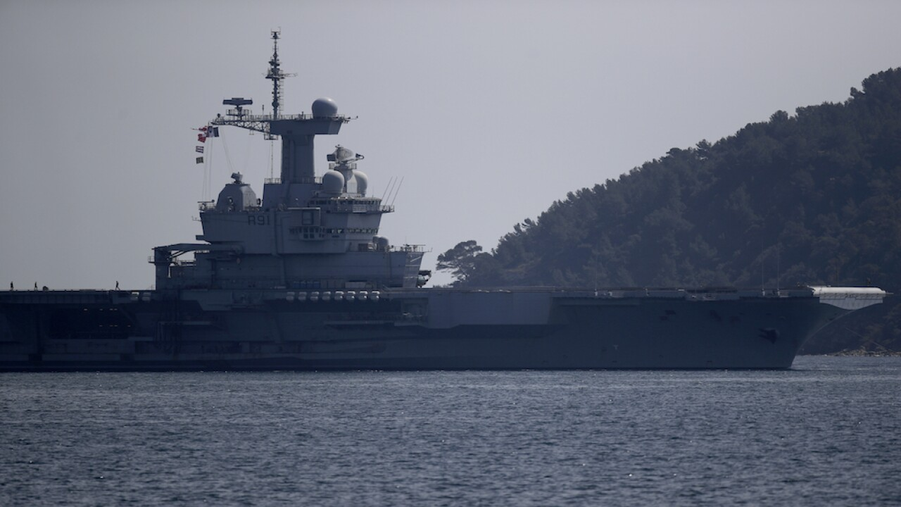 French investigate 900-plus virus cases on aircraft carrier