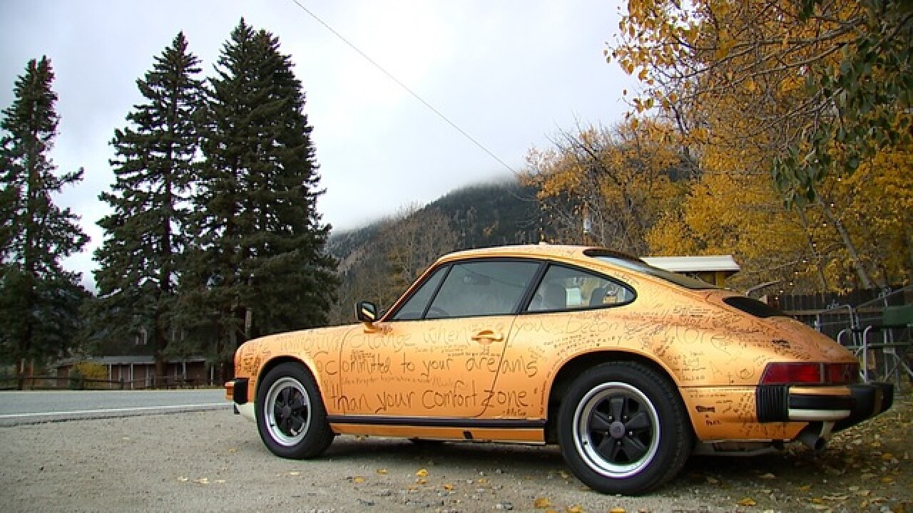 Why this orange Porsche is covered in words