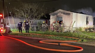 Mobile home catches fire near Corn Products Road