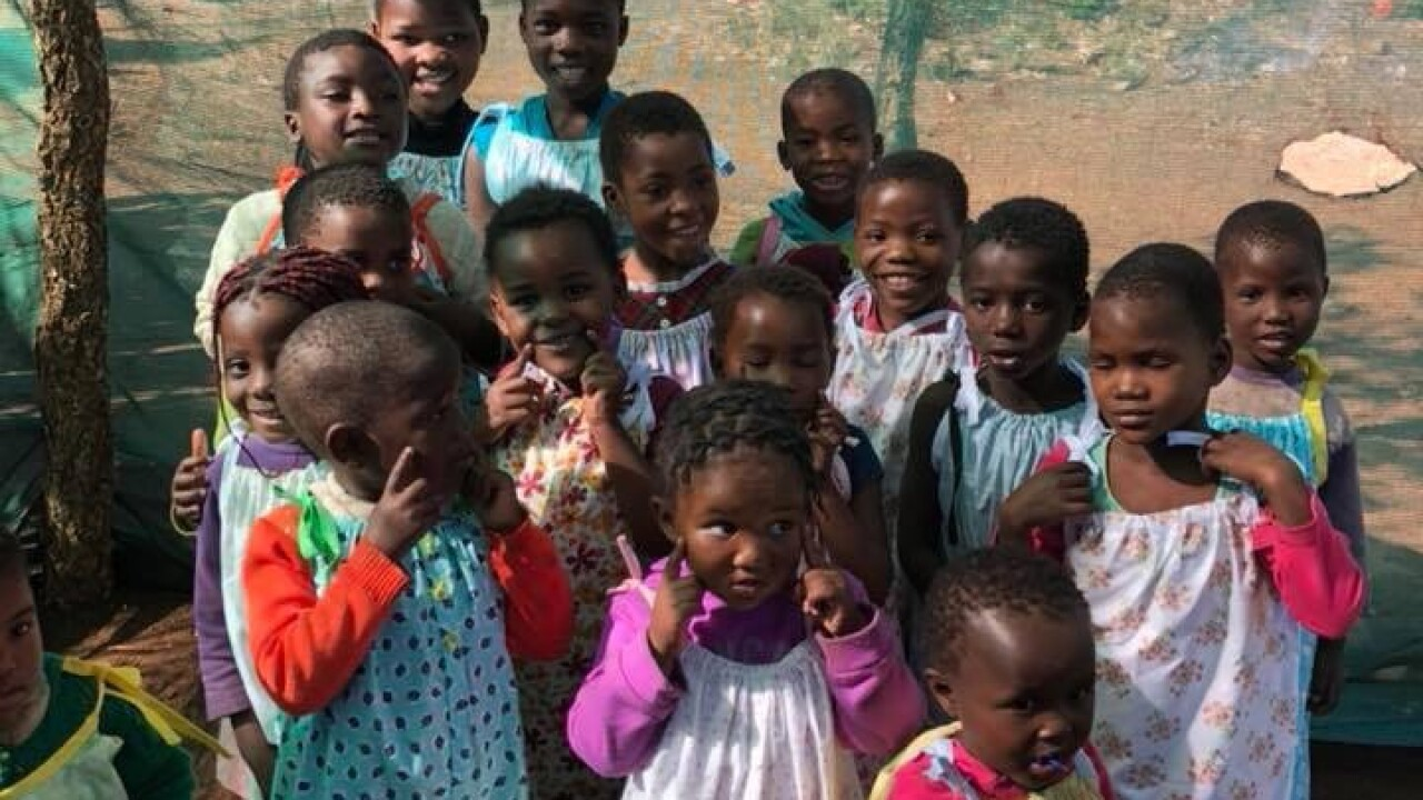 Children receive dresses from Linda and friends