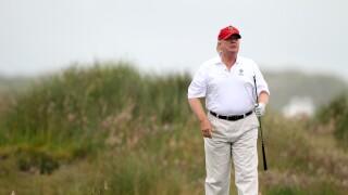 Donald Trump plays golf
