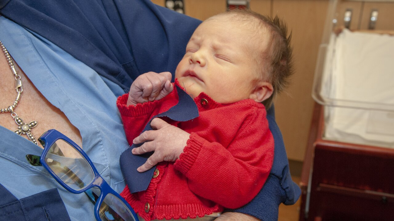 Newborns dressed up as Mister Rogers for World Kindness Day