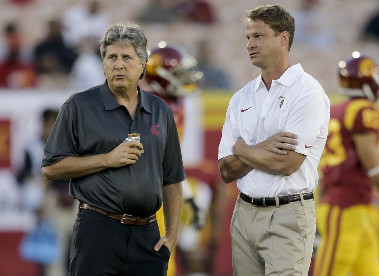 Washington State coach Mike Leach and USC coach Lane Kiffin in 2013
