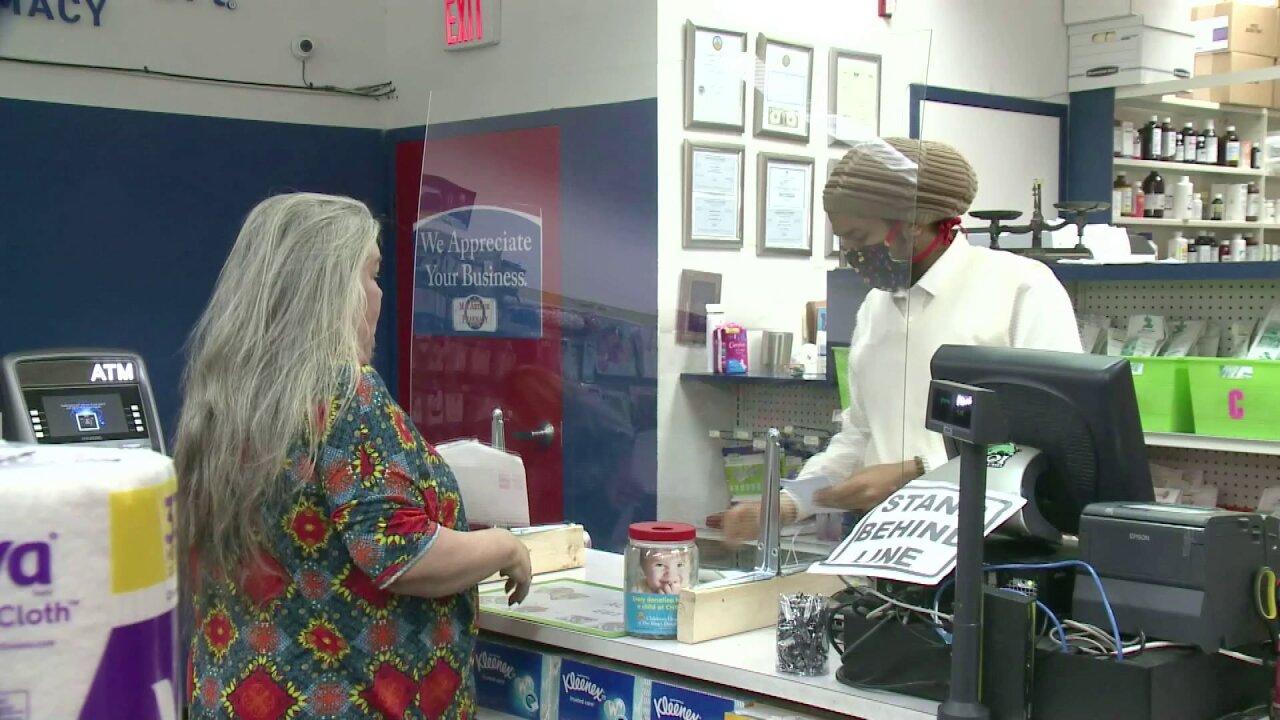 Pharmacists working during pandemic.jpeg