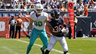 Chicago Bears safety DeAndre Houston-Carter intercepts pass in front of Miami Dolphins tight end Adam Shaheen in 2021 preseason game