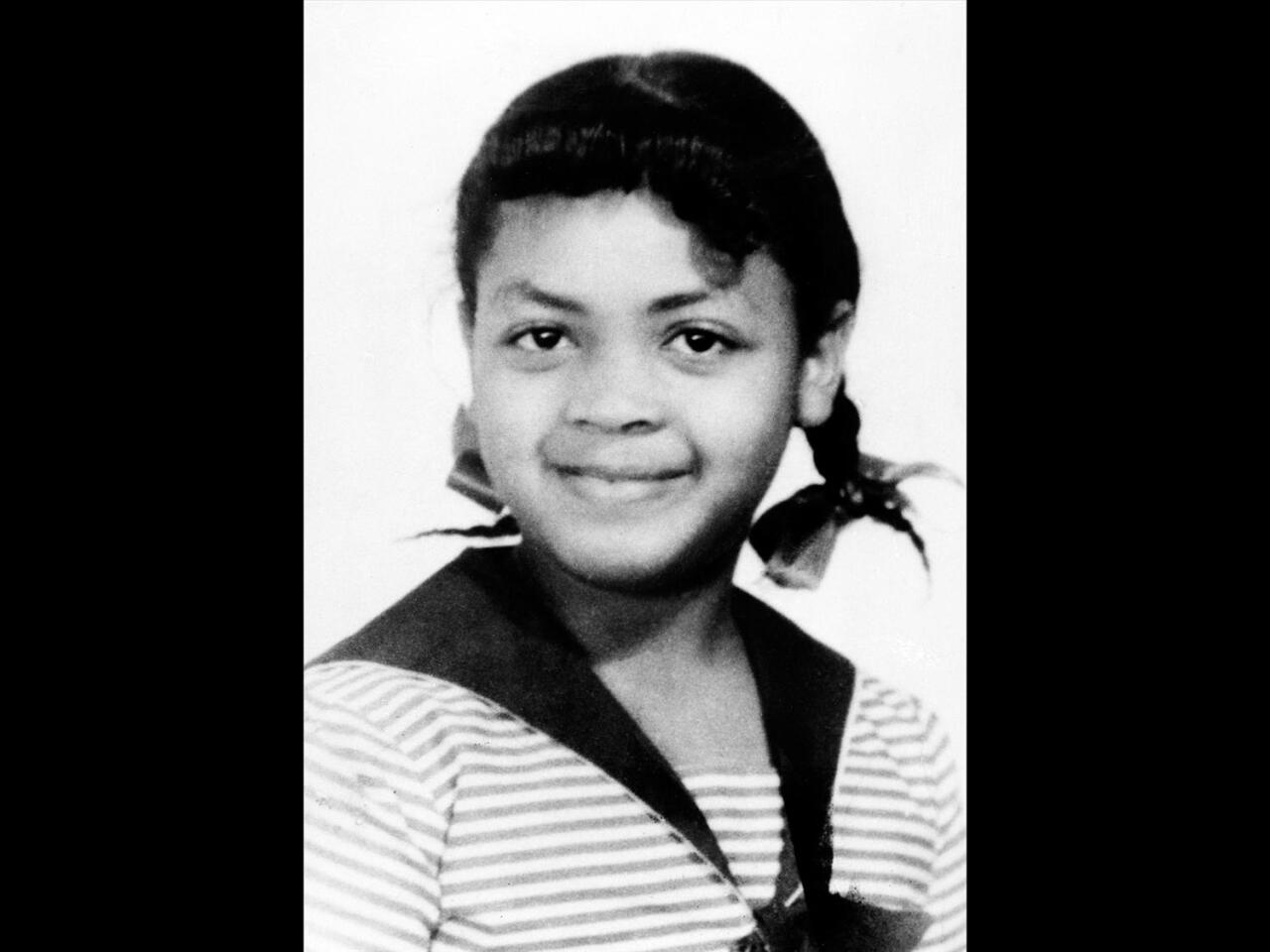 Linda Brown headshot, plaintiff in US Supreme Court Brown v. Board of Education of Topeka, Kansas case, B&W photo on black
