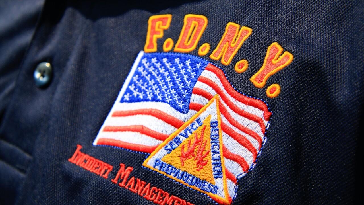 FDNYfirefighterhelp2.jpg