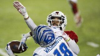 Memphis Tigers receiver Tahj Washington catches ball over FAU Owls cornerback Diashun Moss in 2020 Montgomery Bowl