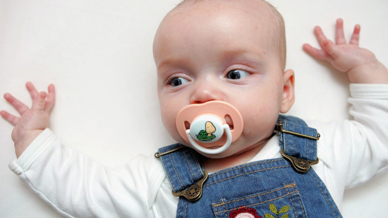 Sucking your baby's pacifier may benefit their health, study says