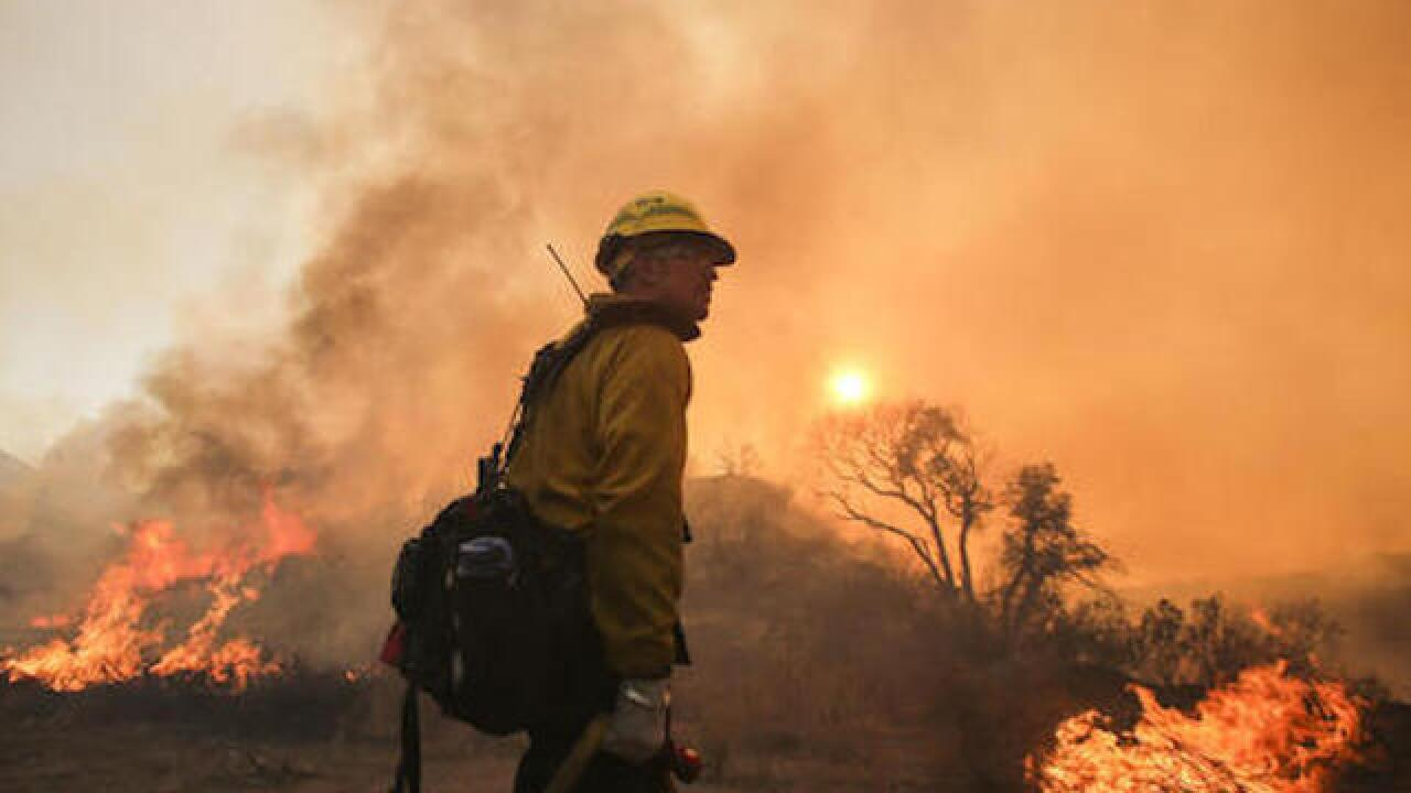 Thousands chased from homes as winds revive California wildfires