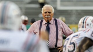 FAU Owls head coach Howard Schnellenberger looks at team before game in 2010