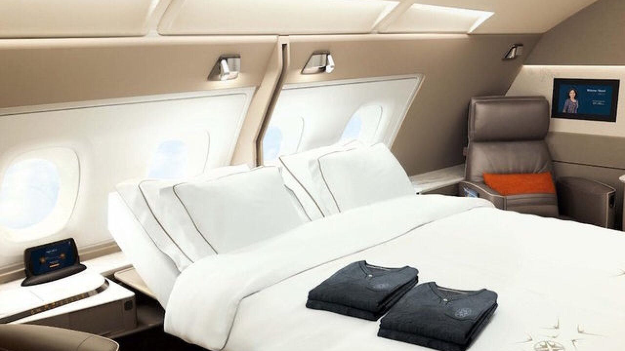 Double beds and swivel chairs are in Singapore Airlines' new luxury suites