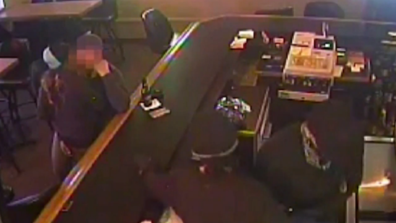 Oblivious couple kisses through bar robbery