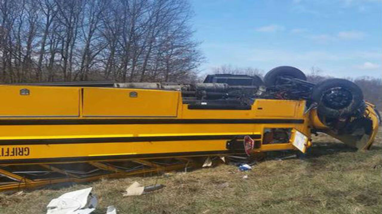 Bus carrying basketball team flips on I-65 in Indiana