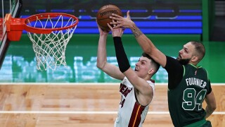 Boston Celtics guard Evan Fournier tries to block Miami Heat guard Tyler Herro, May 11, 2021