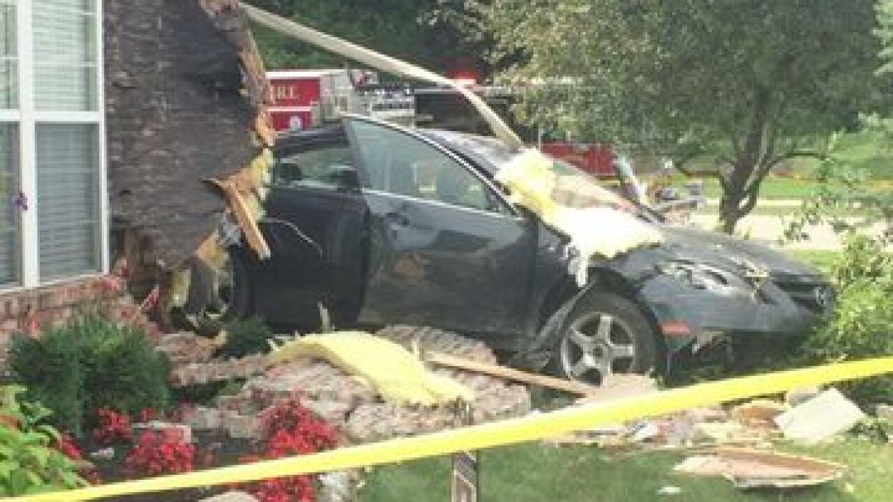 Car crashes into Carmel residence