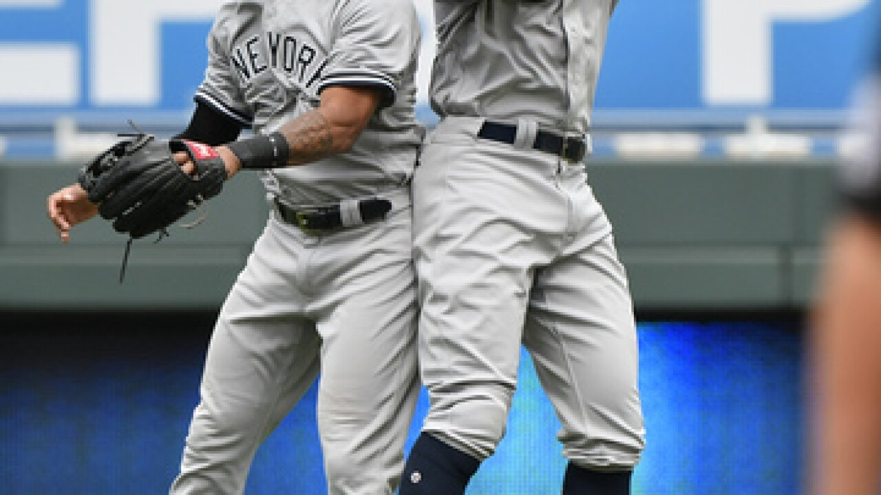 New York hits four more homers, flirts with perfect game, buries Royals by nine