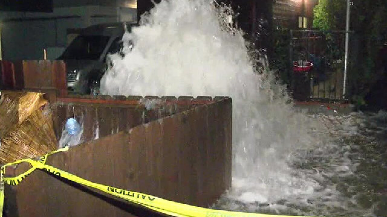 Main break floods Mission Beach-area alley