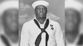 Doris Miller, Mess Attendant Second Class, US Navy, just after being presented with the Navy Cross by Admiral Chester W. Nimitz, on board USS Enterprise (CV-6) at Pearl Harbor, 27 May 1942. The medal was awarded for heroism on board USS West Virginia (BB-48) during the Pearl Harbor Attack, 7 December 1941.