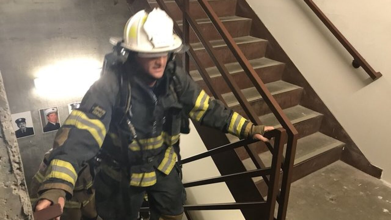 Firefighters climb 110 stories as 9/11 tribute