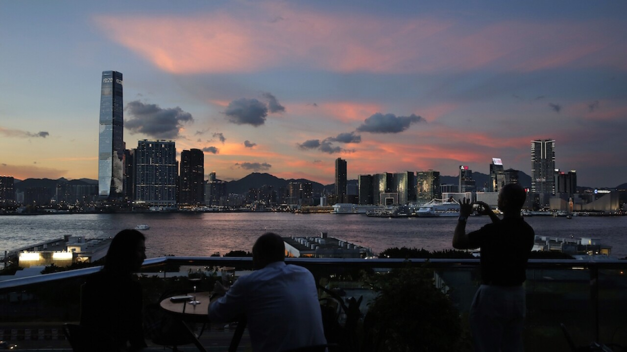 Hong Kong to require all overseas travelers, except China, to quarantine in hotel for 14 days