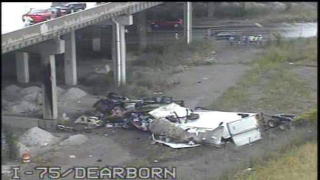Semi goes through wall, falls off I-75 bridge