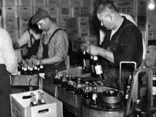 Workers_at_Pilsener_Brewery_pack_cases_of_POC_beer_for_distribution.jpg