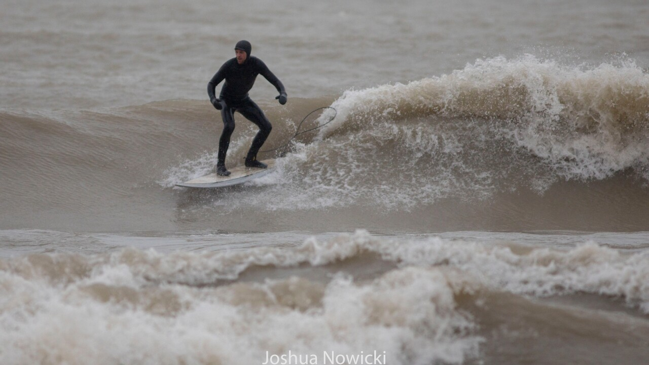 Surfers on Lake Michigan - Courtesy JOSHUA NOWICKI PHOTOGRAPHY