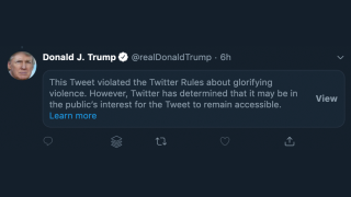 Twitter hides Trump tweet for violating terms of service on 'glorifying violence'