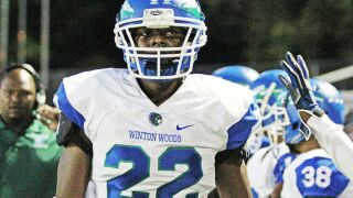 Winton Woods standout linebacker Chris Oats signs with the University of Kentucky