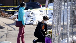 Mourners leave flowers at site of mass shooting in Boulder, Colorado